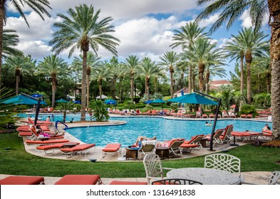 Las Vegas, Nevada - August 4, 2018: Outdoor tropical pool area at the JW Marriott hotel and resort, with poolside lounge chairs , beautiful landscaping and palm trees