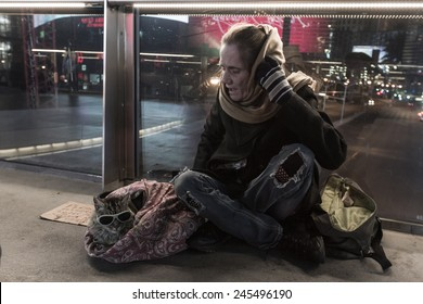 Las Vegas Nevada - December 18 : Homeless woman sitting on an overpass with her cat, December 18 2014 in Las Vegas, Nevada