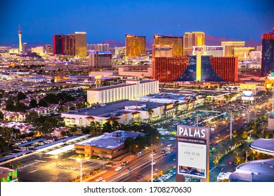 LAS VEGAS, NEVADA - FEBRUARY 23, 2020: Evening view across Las Vegas from above with lights and  resort casino hotels in view.