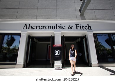 LAS VEGAS, NEVADA - FRI. JUNE 27, 2014:  Shoppers walk past an Abercrombie & Fitch store in Las Vegas, Nevada, on Friday, June, 27, 2014.