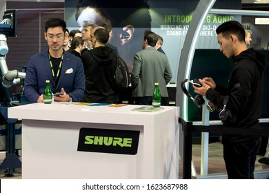 LAS VEGAS, NEVADA - January 9, 2020: Young asian male exhibitors at the Shure counter at the annual Consumer Electronics Show