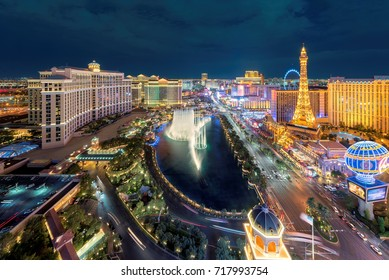 LAS VEGAS, NEVADA - July 25, 2017: Aerial view of Las Vegas strip at night on July 25, 2017 in Las Vegas, Nevada. Bellagio hotel, Caesars Palace and Paris Hotel and casino are in the background.