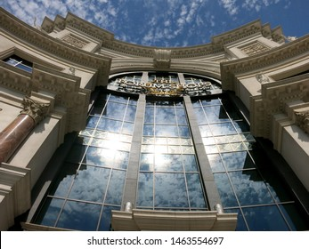 """Las Vegas, Nevada - June 29, 2015: """"The Forum Shops"""" sign and blue sky; mall connected to Caesars Palace; extension wing of main casino; simulates ancient Roman streets including fountains, statues."""