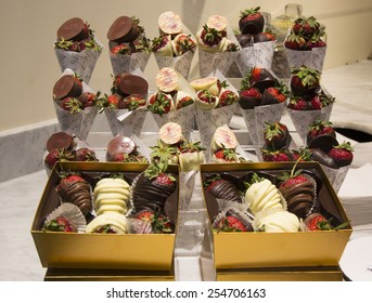 LAS VEGAS, NEVADA - MAY 10, 2014: Milk and Dark Chocolate Dipped Strawberries by Godiva on display in Las Vegas. Godiva Chocolatier is a manufacturer of premium chocolates founded in Belgium in 1926.
