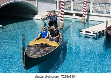 LAS VEGAS, NEVADA - MAY 16, 2012: A couple takes a ride in a gondola at The Venetian Resort Casino located on the Las Vegas Strip.