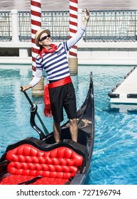 LAS VEGAS, NEVADA - MAY 16, 2012: A gondolier at The Venetian Resort Casino rows his gondola and sings to the crowds on the Las Vegas Strip.