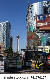 LAS VEGAS, NEVADA - MAY 16, 2012: People drive past the landmark Riviera Hotel located on the Las Vegas Strip. In the background are the Circus-Circus and Stratosphere Hotels.