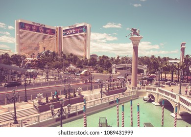 LAS VEGAS, NEVADA - MAY 18, 2017:  View of The Venetian and Mirage Hotel Resort and Casino along the Vegas Strip on a sunny day. This image has a vintage filter effect.