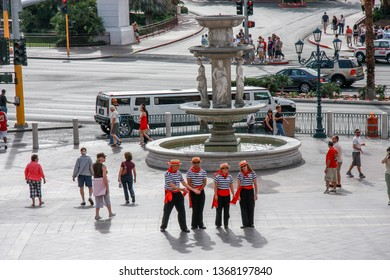 LAS VEGAS, NEVADA - MAY 4, 2009: A group of gondoliers posing against the backdrop of a fountain in the square near the Venetian Hotel located at Strip on May 4, 2009 in Las Vegas, Nevada.