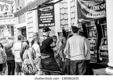 LAS VEGAS, NEVADA - MAY 4, 2009: A group of people stand in line to the gambling slot machines at Strip street on May 4, 2009 in Las Vegas, Nevada.