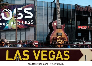 Las Vegas, Nevada - November 13, 2018 Open Top Double Deck Sightseeing Bus and Hard Rock Cafe in Las Vegas Strip, US