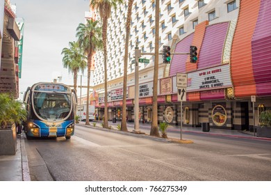Las Vegas, Nevada, November 22, 2017: Colorful scene with Las Vegas public transportation - a bus -  stopped by one of the casinos along the Fremont Street Experience, downtown.