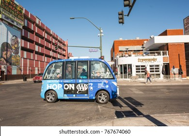 Las Vegas, Nevada, November 22, 2017: People getting on the famous self driving bus that conveys passengers around the city. The shuttle service stops downtown in front of Container Village Park.