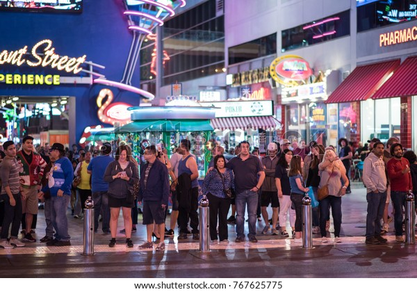 Las Vegas, Nevada, November 24, 2017: People enjoying the evening at the famous and historic Fremont Street Experience, downtown Las Vegas. Millions visit Las Vegas yearly.