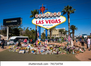 LAS VEGAS, NEVADA - OCTOBER 15, 2017 - People gathering at the memorial by the Las Vegas sign after the horrible mass shooting on October 1st.