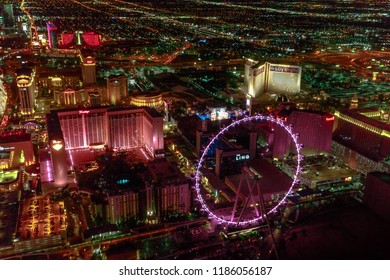 Las Vegas, Nevada, United States - August 18, 2018: aerial view of Las Vegas Strip Skyline illuminated by night. Scenic flight above: High Roller, The Linq, The Mirage and Flamingo Casino and Hotel.