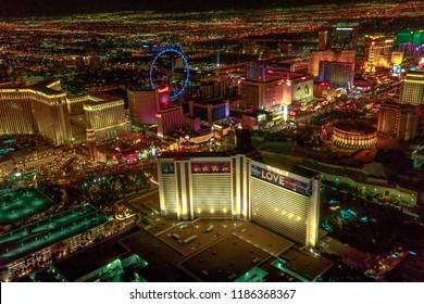 Las Vegas, Nevada, United States - August 18, 2018: aerial view of Las Vegas Strip by night. Scenic flight: High Roller Ferris Whell, The Mirage, Flamingo, Caesars Palace, The Paris, Casino Bellagio.