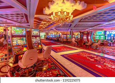 Las Vegas, Nevada, United States - August 18, 2018: people playing at the slot machine inside the Wynn in the Las Vegas Strip. Interior of luxurious Hotel and Casino