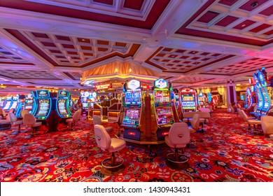 Las Vegas, Nevada, United States - August 18, 2018: many slot machine inside the Wynn in Las Vegas Strip. Luxurious interior architecture of the five-star Casino Hotel.