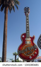 LAS VEGAS (NEVADA), USA - AUGUST 18. 2009: View on guitar of Hard Rock Cafe with palm tree against blue sky