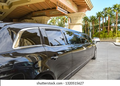 LAS VEGAS, NEVADA, USA - FEBRUARY 2019: Stretched limo parked in front of the entrance to the Mandelay Bay hotel on Las Vegas Boulevard, which is also know as the Las Vegas Strip.