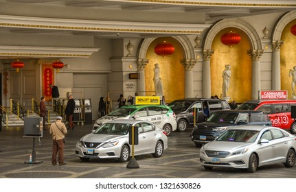 LAS VEGAS, NEVADA, USA - FEBRUARY 2019: Taxis queuing to pick up people from the front of the Caesars Palace Hotel in Las Vegas.