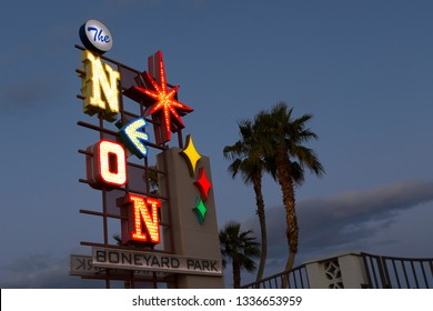 Las Vegas, Nevada, USA, February 6, 2019 - The Neon Boneyard Park sign designed in a vintage style for the Neon Museum seen at dusk