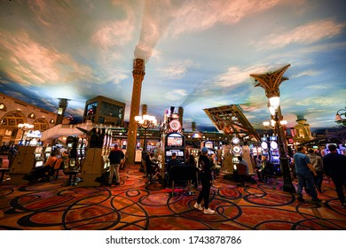 LAS VEGAS, NEVADA, USA - JANUARY 2, 2020: Rows of casino slot machines with shallow depth of field. Las Vegas known for gambling, shopping, fine dining, entertainment, nightlife.