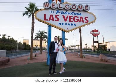 Las Vegas, Nevada, USA - June 18, 2015: Happy newlyweds in Las Vegas posing near Welcome To Fabulous Las Vegas sign