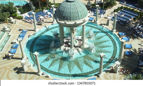 Las Vegas, Nevada, USA - June 20, 2013: People swimming and relaxing at the Caesars Palace Casino pool area in Las Vegas.