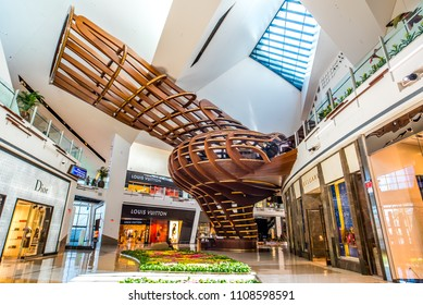 Las Vegas, Nevada / USA - March 18, 2018: The Shops at Crystals interior at The Aria Resort and Casino featuring Maestro's Ocean Club inside a wooden tree house sculpture on March 18, 2018.