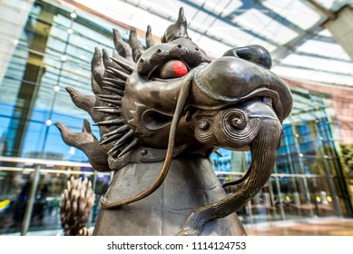 """Las Vegas, Nevada / USA - March 18, 2018: The exterior of the Aria Resort and Casino featuring a cast bronze statue, """"Kirin"""" by Li Xiangqun, that is part of the Aria Fine Art Collection."""