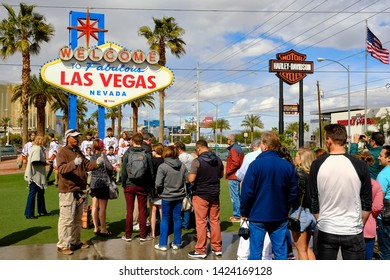 Las Vegas, Nevada / USA - March 06 2019: People queuing to have their picture taken in front of the famous Welcome to Las Vegas sign.