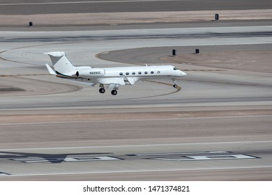 Las Vegas, Nevada, USA - May 6, 2013: Gulfstream G550 luxury business jet N928GC on approach to land at McCarran International Airport Las Vegas.