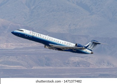 Las Vegas, Nevada, USA - May 8, 2013: United Express Bombardier CRJ-701ER regional jet airliner taking off from McCarran International Airport in Las Vegas.