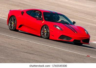 Las Vegas, Nevada / USA - May 20, 2012 - Exotics Racing clients circulating Las Vegas Motor Speedway road course at speed.