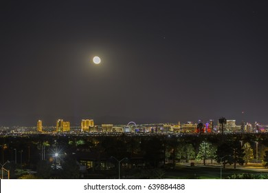 Las Vegas, Nevada, USA - May 13, 2017:  Moon rising over the lights of the Las Vegas strip in Southern Nevada.