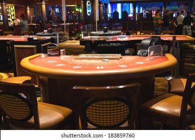 LAS VEGAS, NEVADA, USA - OCTOBER 23, 2013 : Gaming tables in the lobby of casino Treasure Island, Las Vegas