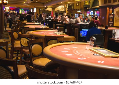 LAS VEGAS, NEVADA, USA - OCTOBER 23, 2013 : Gaming tables in the lobby of casino Treasure Island, Las Vegas. This Caribbean themed resort has an hotel with 2,884 rooms, and located on Las Vegas Strip