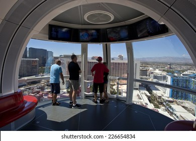 Las Vegas, Nevada, USA - Sept 22, 2014: Tourist overlooking the Las Vegas Strip on the High Roller Ferris Wheel in Las Vegas, Nevada, USA on Sept 22, 2014