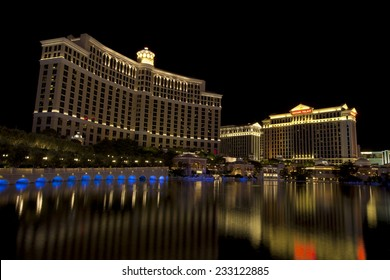 Las Vegas, Nevada, USA - Sept. 25, 2014: Buildings at the Bellagio casino and hotel reflecting in the fountain lake a night along the Las Vegas Blvd in Las Vegas, Nevada, USA on Sept. 25, 2014
