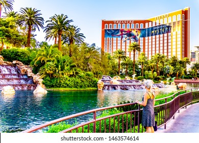 Las Vegas, Nevada/USA - June 8, 2019: The Lake and Waterfalls at The Mirage Resort and Casino on Las Vegas Boulevard, also famously called The Strip. The Treasure Island Resort and Casino behind
