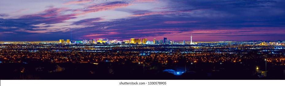 Las Vegas night city skyline panorama with strip hotels and casinos and old Vegas.