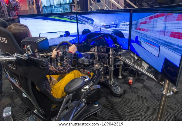 LAS VEGAS - NOV 05 : Race car Simulator at the SEMA Show in Las Vegas, Navada, on November 05, 2013. The SEMA Show is the premier automotive specialty products trade event in the world.