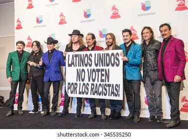 LAS VEGAS , NOV 19 : Members of the music groups Mana and Los Tigres Del Norte hold up a sign in the press room during the 16th Annual Latin GRAMMY Awards on November 19 2015 in Las Vegas, Nevada