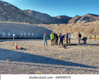 LAS VEGAS, NOV 5TH, 2017: A group of people standing in front of targets at an outdoor shooting range in the desert of Las Vegas, Nevada.