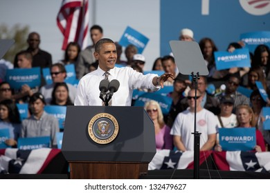 LAS VEGAS - NOVEMBER 01: Barack Obama speaks at a 2012 Election Campaign rally with supporters in the background at Cheyenne Sports Complex on November 01, 2012 in North Las Vegas, Nevada