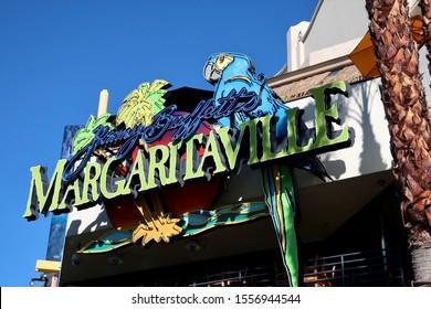 LAS VEGAS - NOVEMBER 11, 2019:  Jimmy Buffett Margaritaville brand logo sign at restaurant exterior