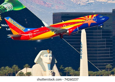 """LAS VEGAS - NOVEMBER 12: Boeing 737 Southwest climbs after take off from McCarran in Las Vegas, USA on November 12, 2010. Plane is wearing New as of 2011 special painting scheme called: Arizona One"""""""