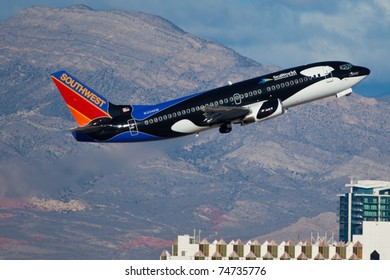 LAS VEGAS - NOVEMBER 12: Boeing 737 Southwest climbs after take off from McCarran in Las Vegas, USA on November 12, 2010. Plean is wearing very speical livery called SHAMU - SeaWorld, FL Advertising